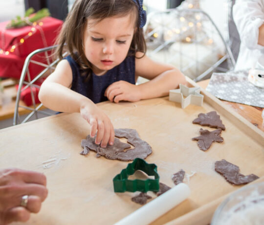 kid making xmas ornaments